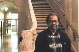 photo of don freeman in front of a staircase