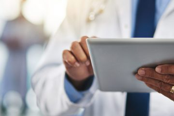 Close-up of a doctor holding a tablet