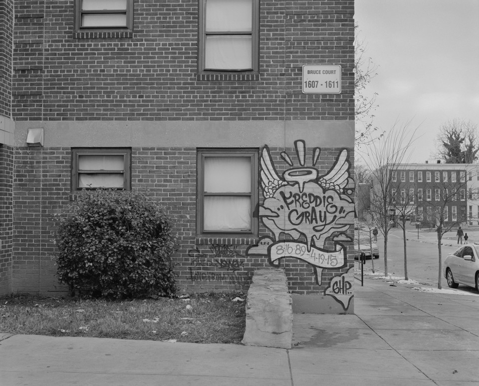 Photo of building graffiti marking spot where Freddie Gray was murdered in Baltimore.