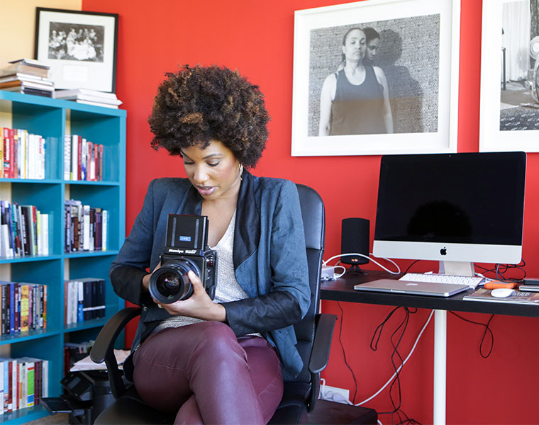Photo of LaToya Ruby Frazier in her office.