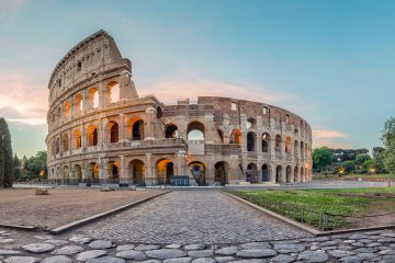 Photo of the sun rising over the Colosseum