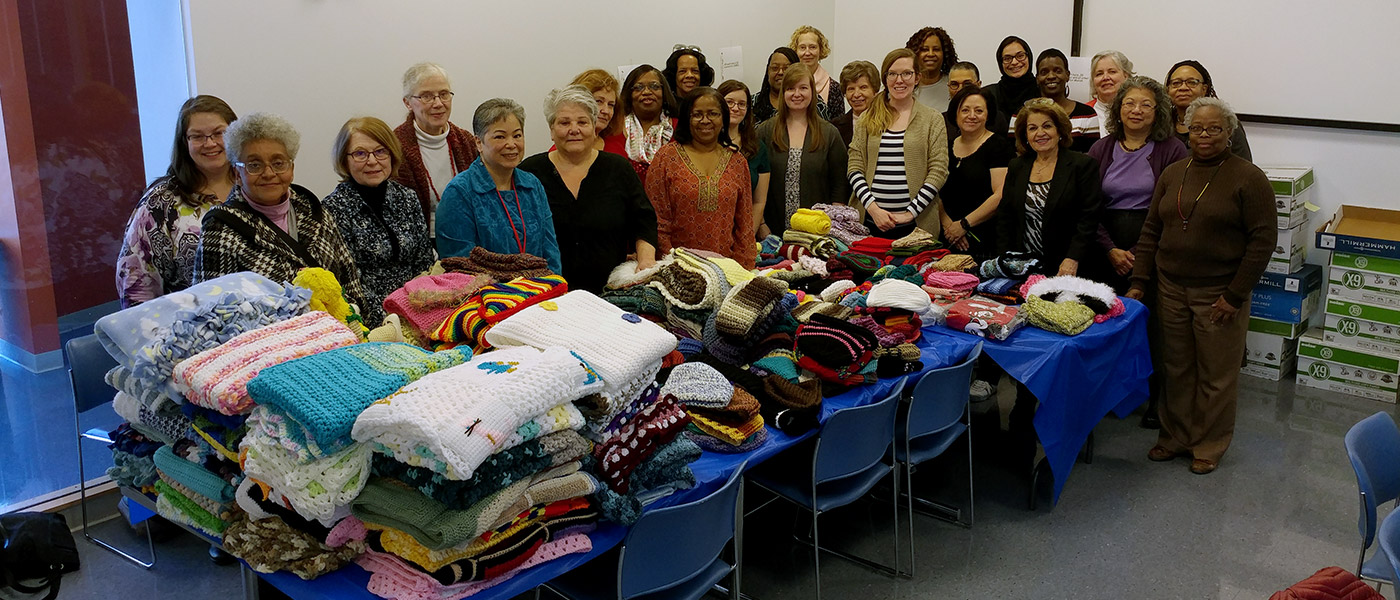 Photos of the Crafters@Case group with the items they've made on a table