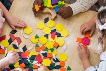 overhead view of kindergarteners playing with shapes