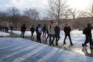 Students walking across Case Quad on a snowy day
