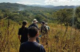 CWRU students walking down a hill near a Costa Rican village