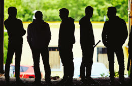 Photo showing the silhouettes of six men