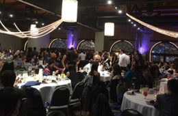 Photo showing students seated at tables during the Graduate Student Appreciation Week Ball