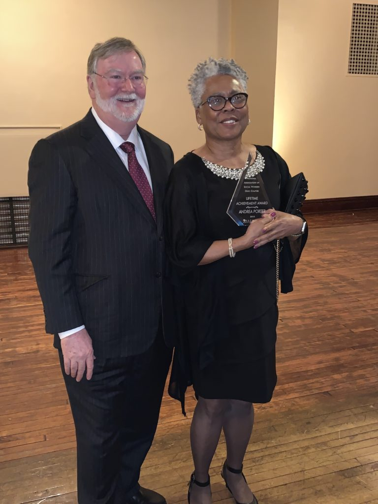 Photo of Grover C. Gilmore and Andrea Porter together with Porter holding the award