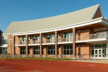 Exterior of the Wyant Athletic and Wellness Center with the track in the foreground