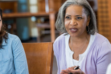 Photo of a woman speaking during a group discussion