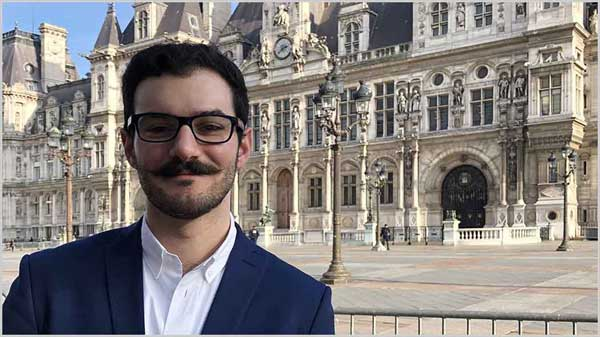 Case Western Reserve University law student Garo Yaghsezian stands in front of the Hôtel de Ville in Paris, France