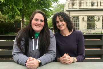 Kasey Clouse and Jamie Bohunicky sitting at a picnic table near the Mandel School of Applied Social Sciences