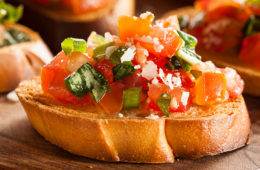 Photo of pieces of tomato bruschetta