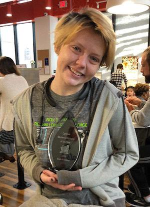Photo of Kayla Buckelew holding her award