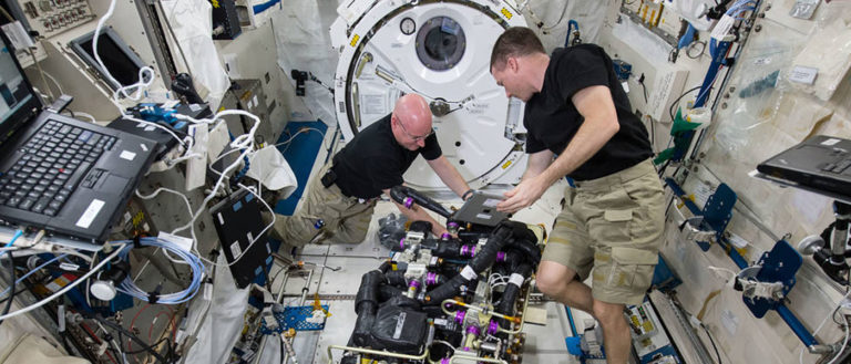 NASA astronauts Scott Kelly and Terry Virts work on a Carbon Dioxide Removal Assembly