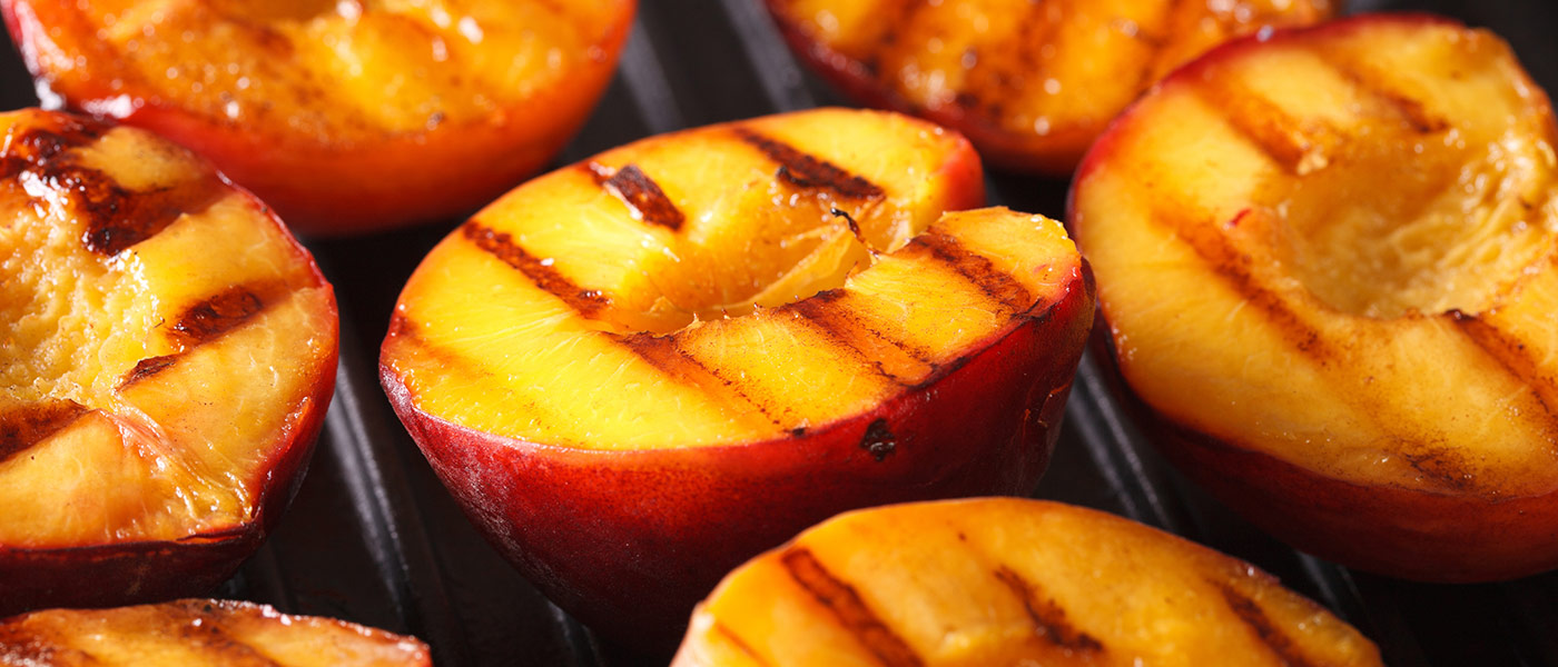 Photo of peaches on a grill