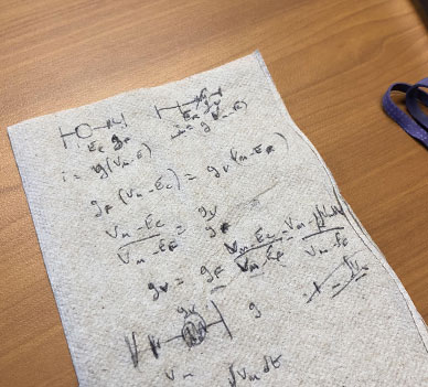 A napkin on the desk of professor Dominique Durand showing Equations which are part of Durand's most recent work.