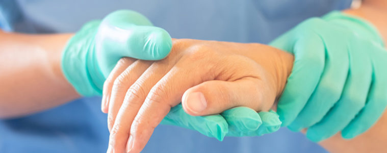 Doctor holding the hand of a patient