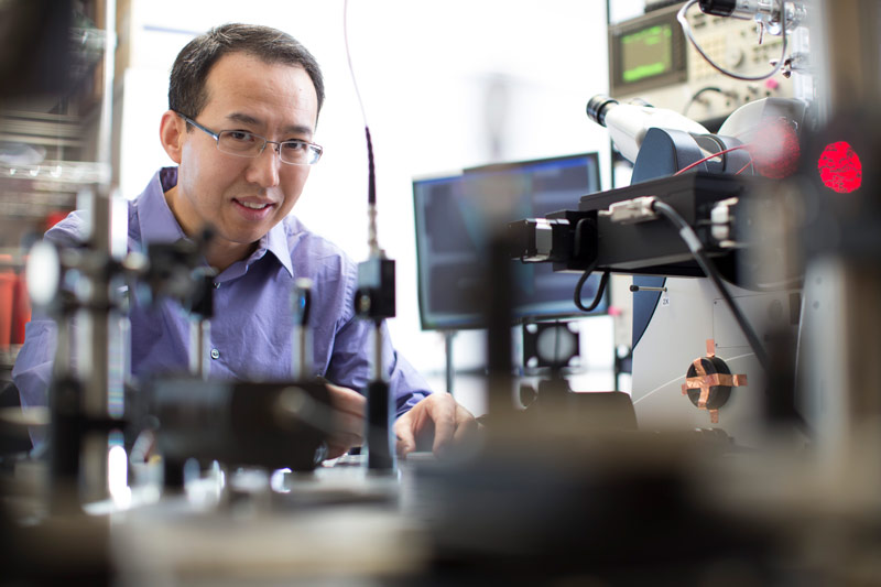 Photo of Philip Feng in a lab setting
