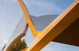 "Photo showing an angle of the ""Start"" sculpture against the sky"