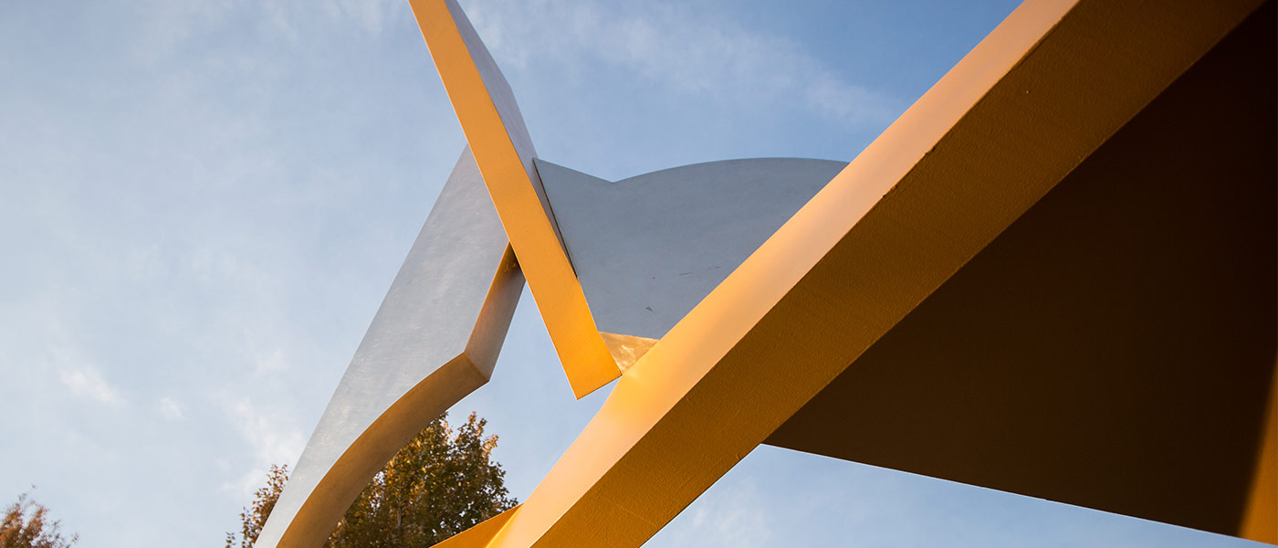 """Photo showing an angle of the """"Start"""" sculpture against the sky"""