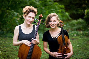 Two female musicians holding string instruments