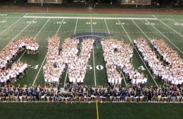 Members of the Class of 2023 spell out CWRU on DiSanto Field