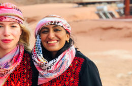 Photo of two female students posing for photo in the Wadi Rum desert of Jordan