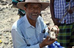 Yohannes Haile-Selassie, holding a cranium fossil