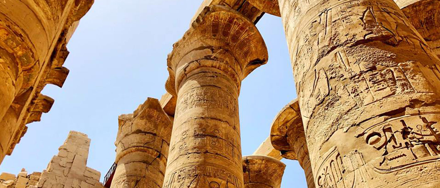 Photo looking up at the columns at the Temple of Karnak in Luxor, Egypt