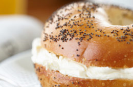 Photo of a bagel with cream cheese on a plate
