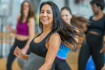Photo of women dancing in a fitness class