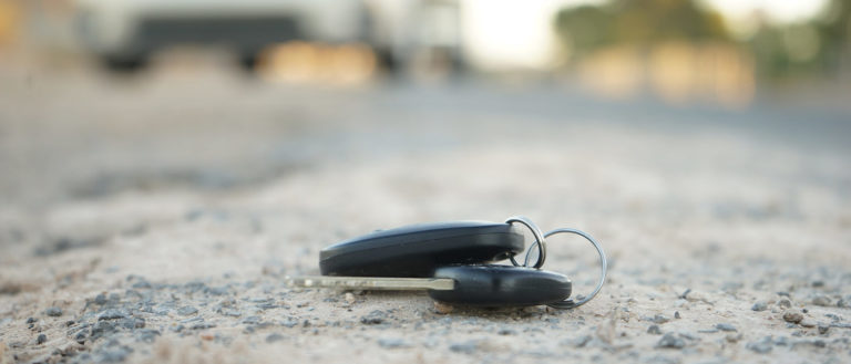 Photo of car keys in the road