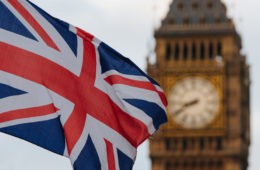 Photo of the British flag in front of Big Ben
