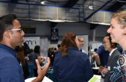 Photo of a student talking to a potential employer at the Career Fair