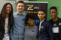 Michael Volkening poses for a photo with the Zlto team