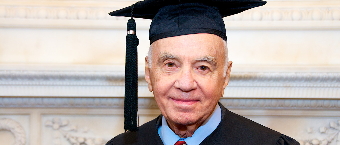 Photo of Morton Mandel in a cap and gown