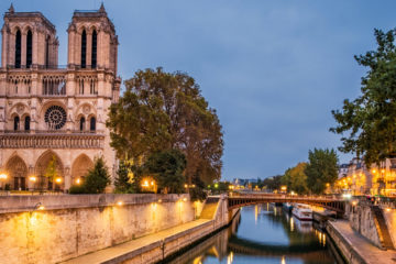Photo of the Notre Dame Cathedral next to the River Seine