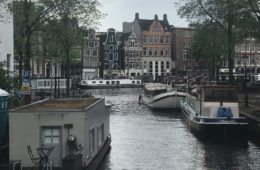 Photo of buildings and boats lining waterways in the Netherlands