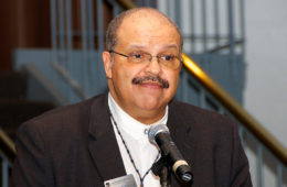 Photo of G. Dean Patterson Jr. speaking at a microphone