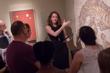 Photo of a faculty member gesturing to a piece of art during a class at the Cleveland Museum of Art