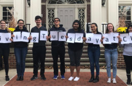 "Photo of students holding up papers that spell out ""#GivingTuesdayatCWRU"""