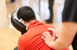 Photo of a man receiving a chair massage