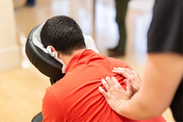 Photo of a man receiving a chair massage