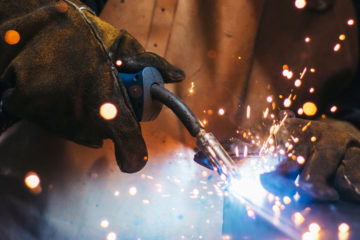 Close-up photo of sparks flying as someone welds