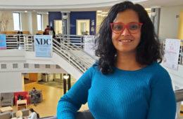 Fehmida Kapadia standing above an atrium