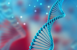 Photo illustration of DNA strand against a blurred background