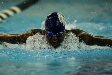 CWRU swimmer Laila Michel swimming in a pool toward the camera