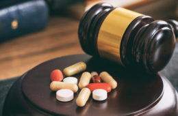 pills near the gavel in a courtroom