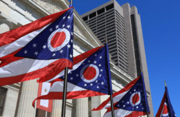 Ohio state flags flying outside the Ohio Statehouse in Columbus, Ohio